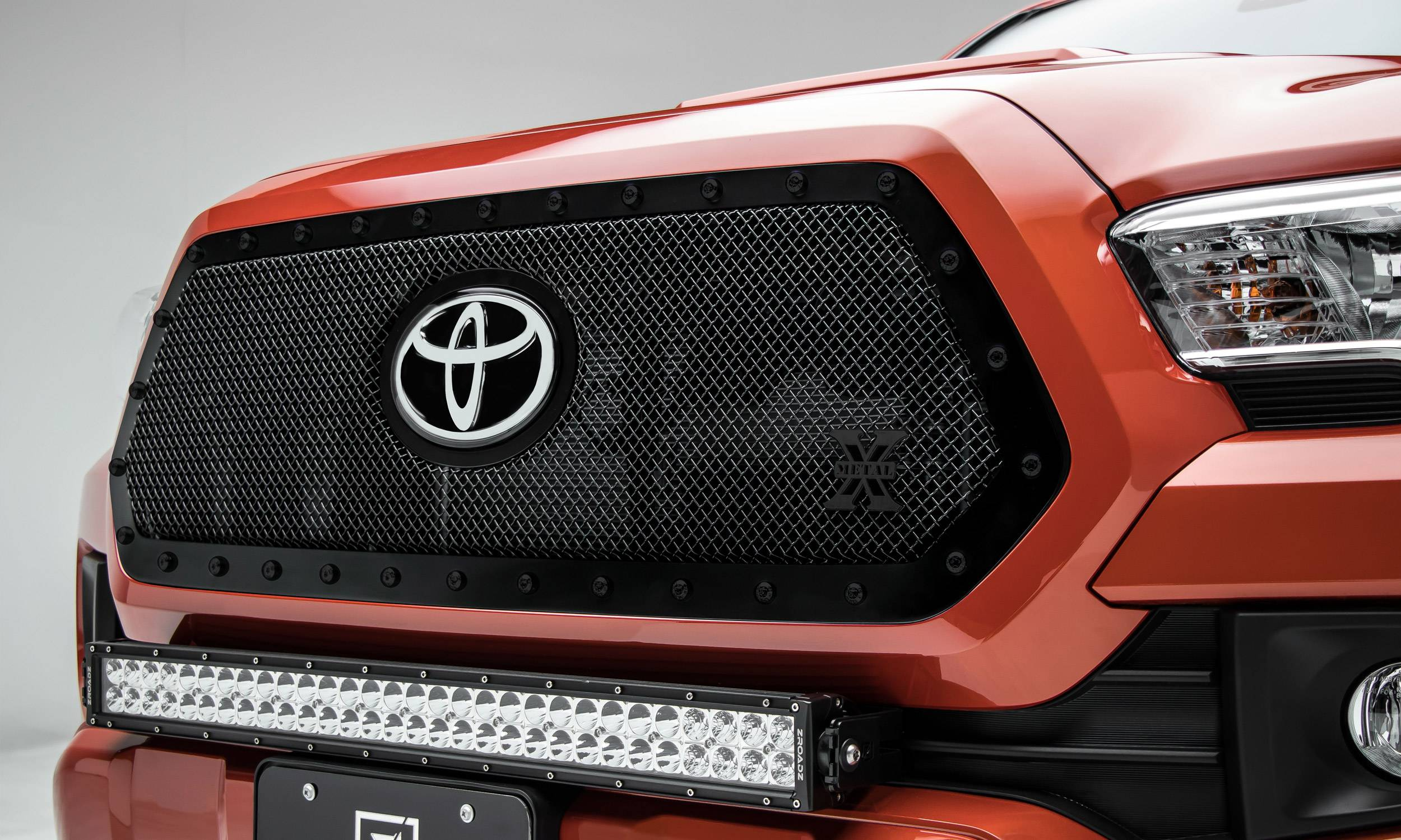T-REX Grilles - 2018-2021 Tacoma Stealth X-Metal Grille, Black, 1 Pc, Insert, Black Studs, Does Not Fit Vehicles with Camera - PN #6719511-BR