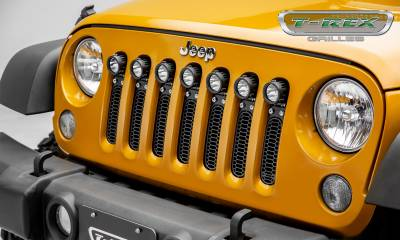 "T-REX Grilles - 2007-2018 Jeep JK, JKU Laser Torch Grille, Black, 1 Pc, Insert, Chrome Studs, Incl. (7) 2"" LED Round Lights - PN #7314841 - Image 1"